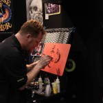 Another artist at the House of Kolors booth laying down some paint with an airbrush.