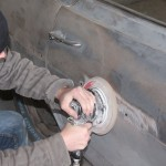 Using a large hi-speed sander, Scotty Mccubbin of Godspeed Customs removed the filler and paint from underneath the trim.