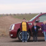 02.	My kids and the Caddy parked in front of Cadillac Ranch on RT 66. I can't think of a more fitting photo op.