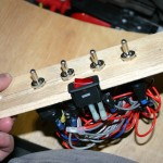 4.	The switch panel is pulled out of the console to gain access to the wires to the solenoids.