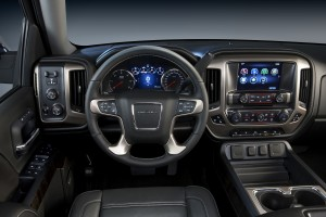 2014 GMC Sierra Denali high-tech interior starts with exclusive metal and wood trim.  Standard features also include two eight-inch screens with an exclusive reconfigurable instrument cluster; Intelli-link with voice commands; five standard USB ports; and front and rear park assist.