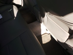 Crappy lighting doesn't hide the lack of foot room in the rear of the Malibu.